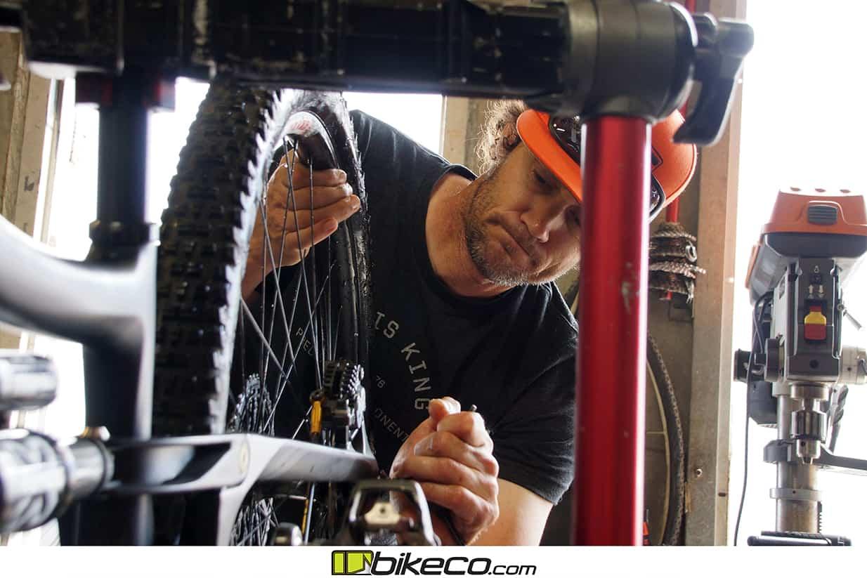 Joe Binatena works on Brian Lopes Ibis Ripmo race bike.