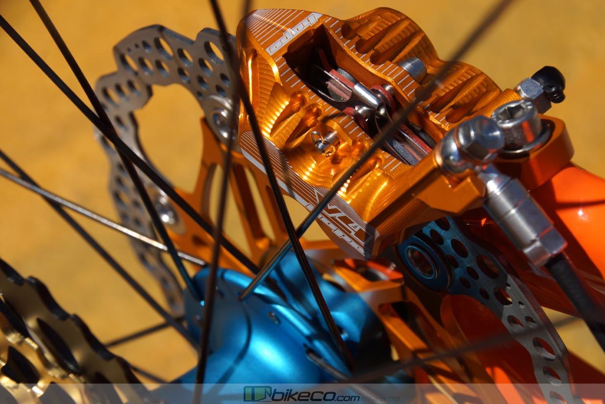 Detail of Orange Hope V4 Caliper with King Matte Turquoise Hub on Orange SB150