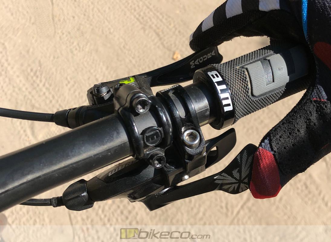 I Shift SRAM GX Eagle Review. magura mt7 brake, GX shifter, WTB grip with rider finger on brake and thumb on shift paddle