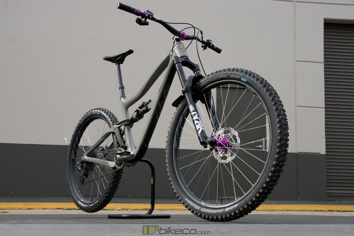 Custom Ibis Ripmo V2 build with rockshox lyric, handbuilt wheels and purple highlights on star destroyer grey frame.