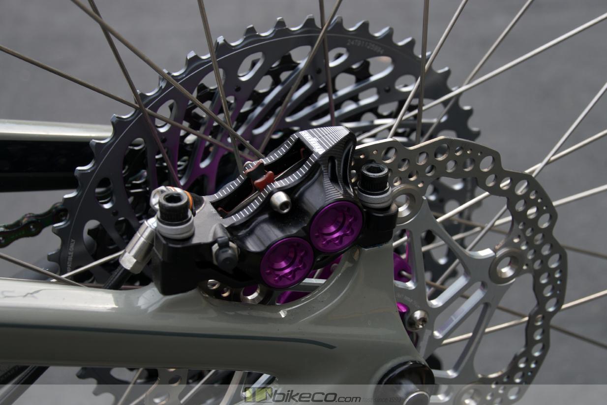 Closeup of Hope E4 Calipers Purple Pucks on Ibis Ripmo build