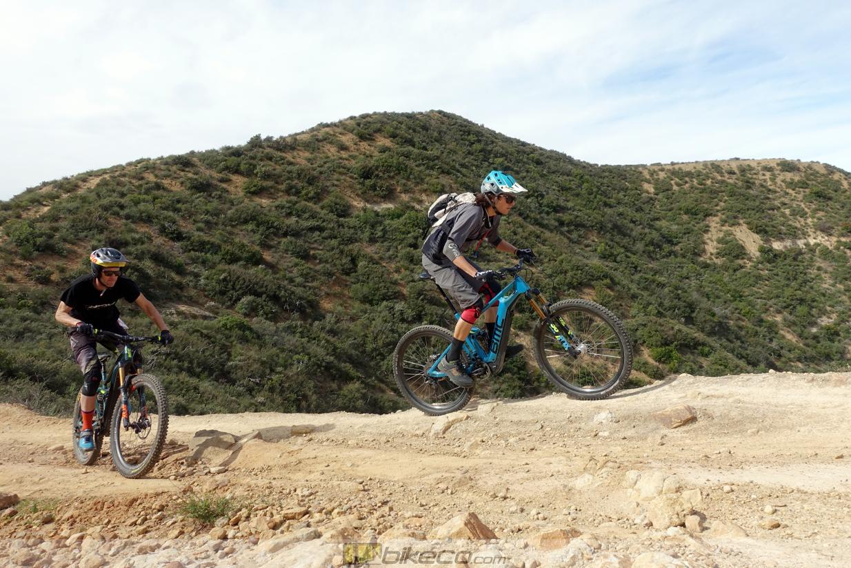 Kevin Aiello and Joe Binatena clim BMC TrailFox AMP APS Suspension e-bikes.